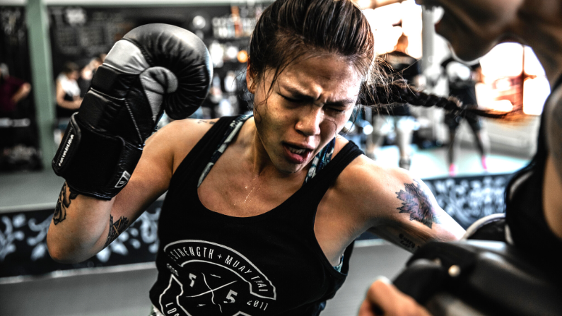 Muay Thai Fighter on Thai Pads